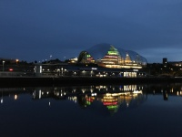 The Sage lit up at night